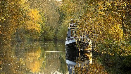 Barge moored on the Kennet and Avon Canal at Padworth, Berkshire