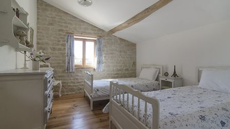 Characterful bedroom with period features in Charente-Maritime