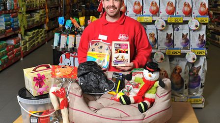 Kevin Gribben with a selection of Christmas gifts for your pet. Photo: Bill Smith
