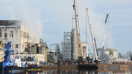 Cranes and heavy lifting equipment ready to lift the new cooling tower into place from the barge moo