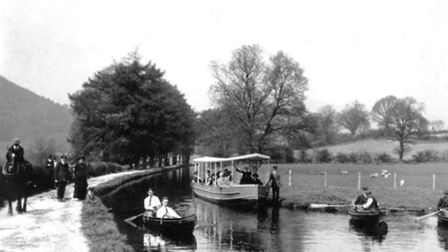 A lively scene at Llangollen in the early 20th century, with a horse-drawn excursion boat