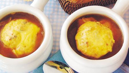 French onion soup topped with a cheesy croutons ©dreamstime