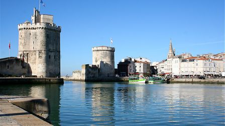 Three tall towers guarding the harbour of La Rochelle act as a reminder of the town's turbulent hist