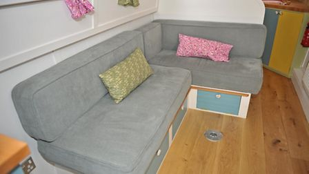 The L-shaped bench converts into a bed
