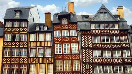 Row of crooked medieval houses in Rennes