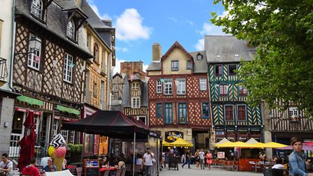 A collection of colourful medieval houses in Rennes © Esinel / Dreamstime