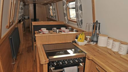 Its a reverse style, with the galley at the stern