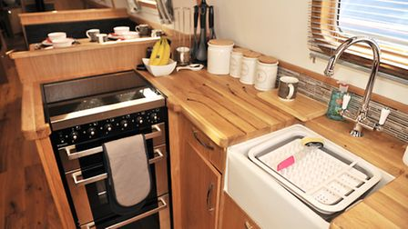 The equipment includes a 12-volt Shoreline fridge, and a Dometic slot-in cooker