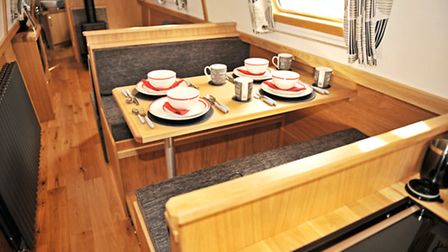 The raised dinette is Pullman style and converts into a guest double bed