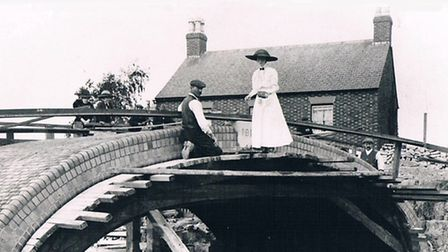 It wasn't just men - bricklayer with lady helper working on a Grand Union bridge