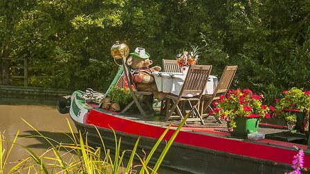 'Wendover' the bear gives amusement to children as the boat passes by