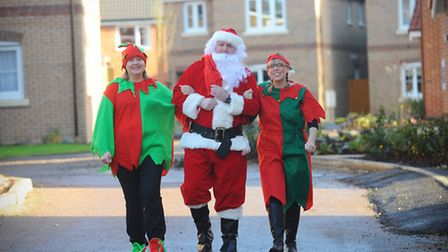 Father Christmas and his elves have a Santa door knock in wymondham visitng children in their homes.