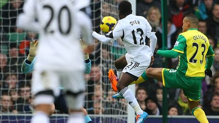 Swansea City's Nathan Dyer lifts over Norwich City's John Ruddy to open the scoring in a 1-1 Premier