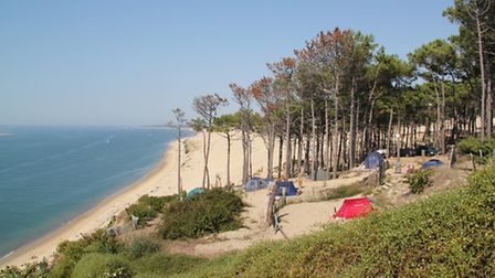 Pitch your tent right by the sea for stunning views at Panorama du Pyla campsite in the Arcachon bay