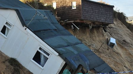 Volunteers have helped construct flood defences in Hemsby.Homes on the Marrams, Hemsby that have sli