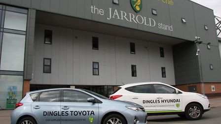 Two of the Dingles Toyota and Hyundai sponsorship cars outsideNorwich City's Carrow Road stadium.