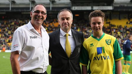 John Dingle, left, managing director of Dingles, and his son Harry, right,with Norwich City chief ex