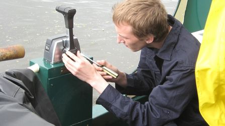 RCR engineer attending to a problem with a boat's gearbox control cable (photo: RCR)