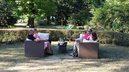 Guests relaxing in the garden at Maison Belmont in the summer