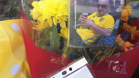 A photograph left in tribute to Daniel Bowyer at Wroxham Road in Rackheath, where he died after cras