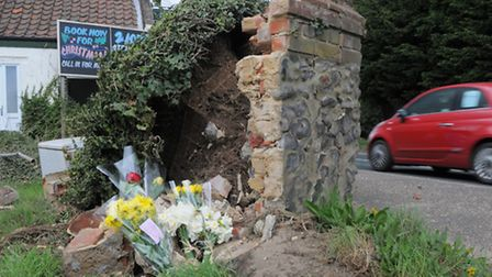 Floral tributes close to the spot where a man lost his life in a fatal collision next to the Green M