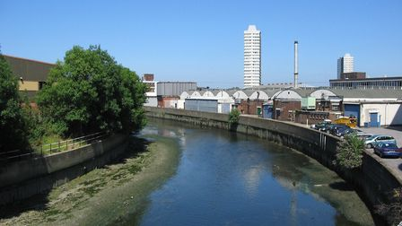 Waterworks River in 2005, with mud, low tide, and industrial surroundings