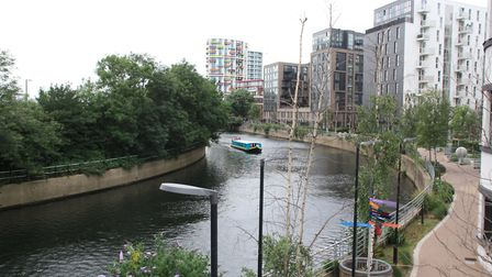 The same scene now: non-tidal and surrounded by new buildings