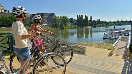 Cyclists admiring the view across the Loire © Joel Damase