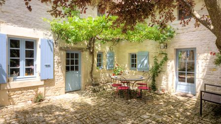 The gorgeous courtyard of a four-bed house in Charente