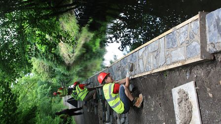 Putting finishing touches on the towpath wall