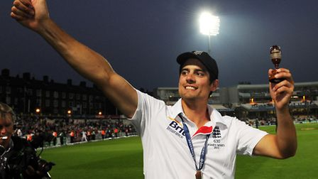 File photo dated 25/08/2013 of England captain Alastair Cook with the Urn as he celebrates winning t