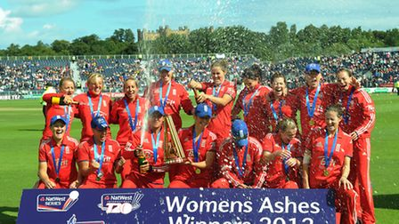 England women's team celebrate with the Ashes trophy during the second Women's International T20 at