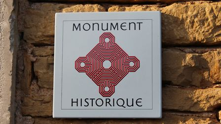 The Monument Historique plaque is inspired by Reims cathedral ©Prieuré Moins Mazille
