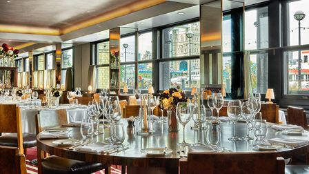 Pont de la Tour's main dining room with a view of the Tower Bridge in London
