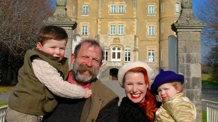 Dick, Angel and their children in front of their French chateau