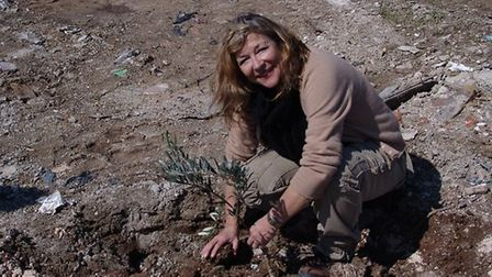 Carol Drinkwater planting an olive tree at her property in Provence
