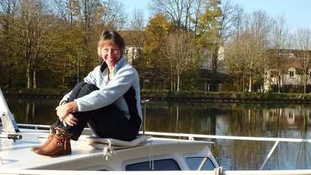 Setting sail: Mary-Jane atop of her houseboat, 'Olivia Rose'