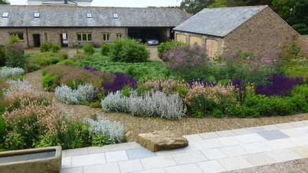 Drifts and repeating harmony work well in this French garden by British garden designer Dan Pearson