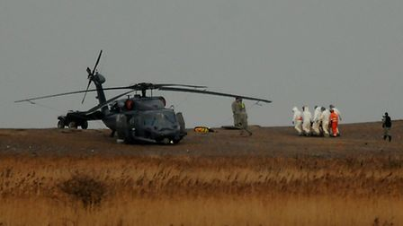 USAF Helicopter crash at Cley. The bodies are recovered.PHOTO: ANTONY KELLY