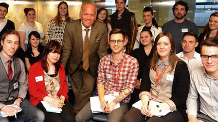Former Dragon, Doug Richard, with City College students after his talk about starting a business. Pi
