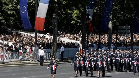 Tricolore colours on parade at the Fete Nationale (c) Atout France