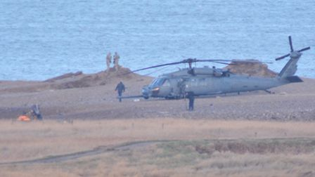 Accident investigators at Cley where one American helicopter crashed killing all on board and a seco