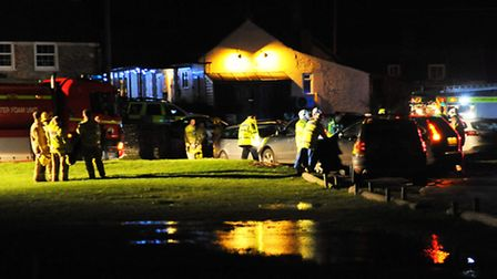Police and fire services at the Dun Cow at Salthouse for the Cley marshes helicopter crash incident.