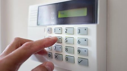 Alarms or cameras can help keep your home secure (c)GettyImages/BrianAJackson
