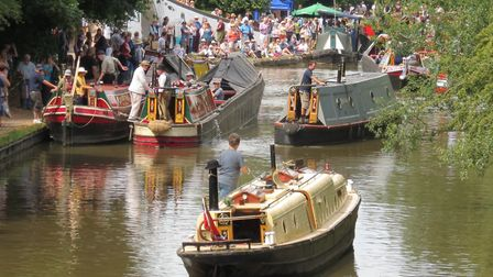 Historic boats fill the canal for the parade (photo: Tim Coghlan)