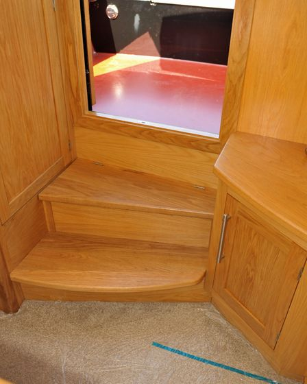 Steps include storage space and a drawer