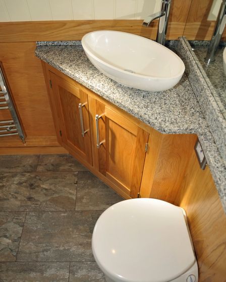 The granite-topped vanity unit in the funky shower room