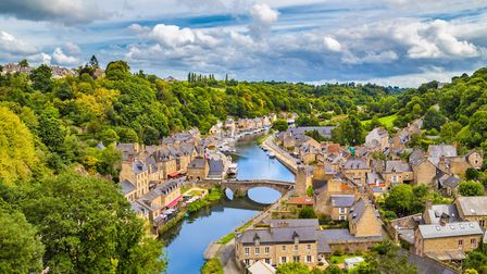The historic town of Dinan on the Rance river, Cotes-d'Armor ©Bluejayphoto/GettyImages