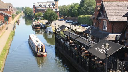 Waterside pub with floating patio in Sale