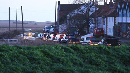 SUVs arrive at the helicopter crash site. Picture: Sarah Whittley